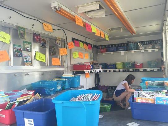Carol Paul has the books organized by topic blue bins
