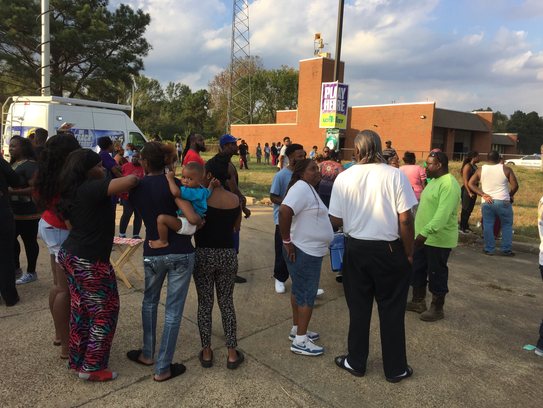 Family and friends gather near the fire station on