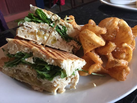 The turkey apple panini sandwich with garlic fries.