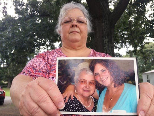 Susan Bro, the mother of Heather Heyer, holds a photo