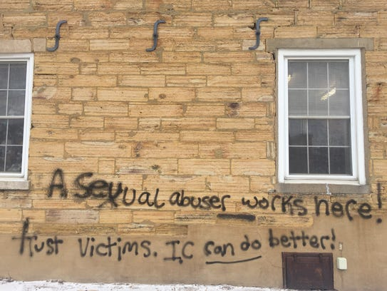 Graffiti on The Haunted Bookshop in Iowa City is shown