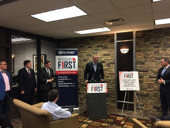 Missouri Treasurer Eric Schmitt talks about changes to the state's linked-deposit loan program on Tuesday, March 20, 2018, at Systematic Savings Bank in downtown Springfield. Standing from left are State Rep. Curtis Trent; Springfield Area Chamber of Commerce President and CEO Matt Morrow; Schmitt; and State Rep. Elijah Haahr