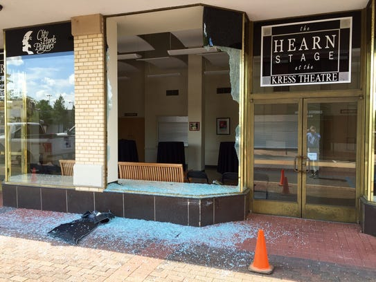 The broken front window of the Kress Theater on Third