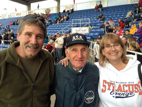 Joe Yanuzzi (center) attends the Wounded Warriors game