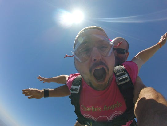 Nick Buckley yells during a free fall with Dennis Bennett