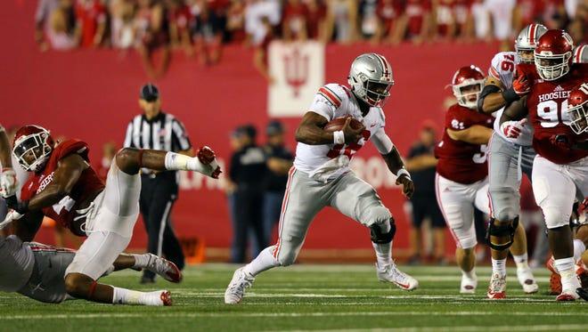 Ohio State Buckeyes quarterback J.T. Barrett looks for room to run.