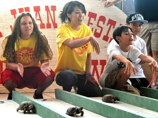 Contestants of all ages gather for the Turtle Derby, part of the the San Juan Turtle Fest in Tortugas, NM.