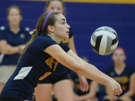 Seton's Rose Chimenti passes the ball during a volleyball match against Hagerstown at Seton Thursday, Sept. 4, 2014.