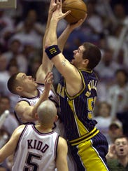 Brad Miller (All-Star in 2002-03) puts up a shot and