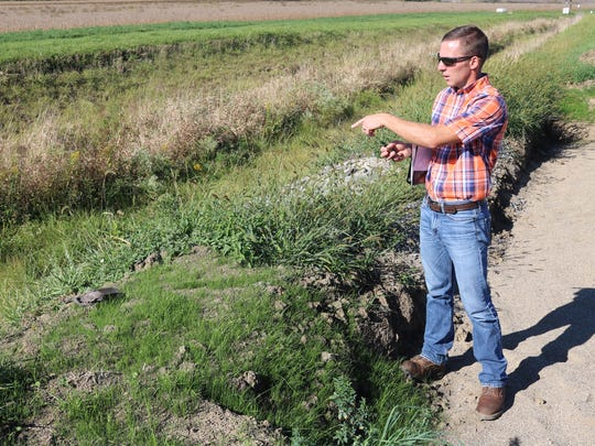 Aaron Heilers, project manager, discusses the two-stage ditch and other conservation practices being tested at Kurt Farm, part of the Blanchard River Demonstration Farms Network.