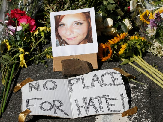 A makeshift memorial of flowers and a photo of victim,