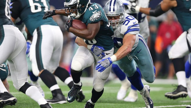 Cowboys linebacker Sean Lee wraps up Darren Sproles for a loss in the third quarter Sunday night.