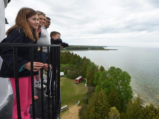 Tina Bednar, children Averi and Brady Bednar and father-in-law Bob Bednar take in the view of Lake Michigan from the top of Cana Island Lighthouse off Baileys Harbor during last year's Door County Lighthouse Festival.