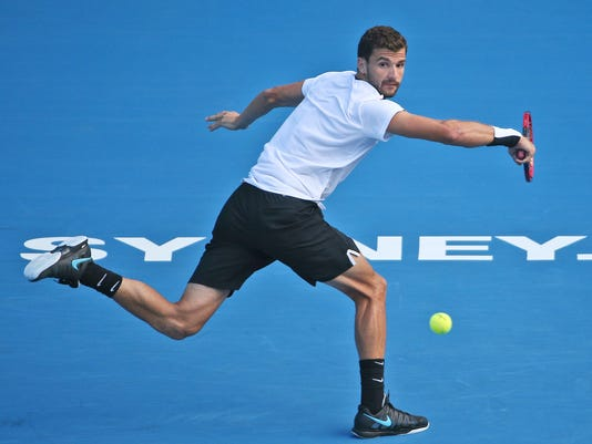 Grigor Dimitrov of Bulgaria plays a shot in his semi-final match against Gilles Muller of Luxembourg during the Sydney International Tennis tournament in Sydney, Australia, Friday, Jan. 15, 2016. (AP Photo/Rob Griffith)