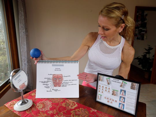 Christine Conti of Brick, owner of Conti Fitness and Wellness, demonstrates her favorite face exercises for counteracting aging and reducing stress at her home in Brick, NJ Thursday February 15, 2018.