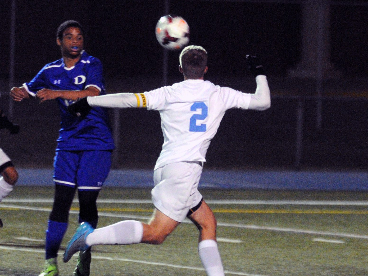 Cape Henlopen senior Jack Ashby (2) chests the ball down to control it in the season finale against Dover.