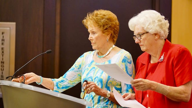 Maricopa County Recorder Helen Purcell, left, and County Eleections Director Karen Osborne, speak at a Board of Supervisors meeting in Phoenix, Ariz., Wednesday, March 30, 2016.