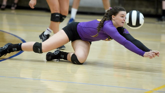 Hagerstown's Victoria Pierson dives after the ball during a TEC volleyball match against Lincoln Thursday, Sept. 15, 2016 in Cambridge City.