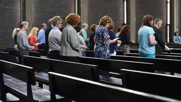 Parish talks repentance as they cope with news of priest's arrest