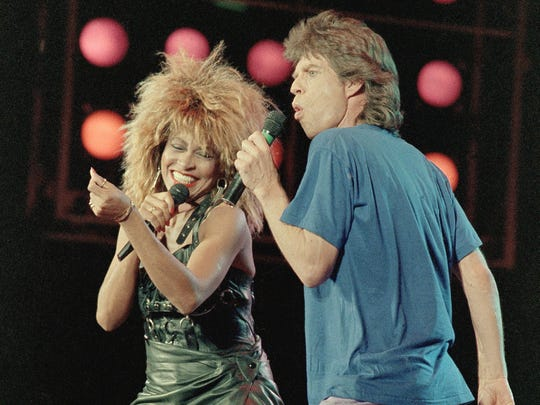 Tina Turner and Mick Jagger share the stage during Live Aid in 1985.