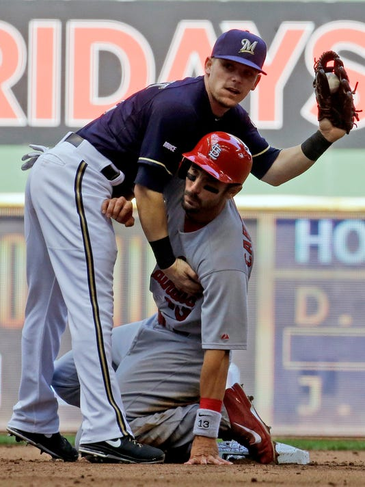 St. Louis Cardinals' Matt Carpenter gets tangled with Milwaukee Brewers' Scooter Gennett after being caught stealing second during the fifth inning of a baseball game Sunday, Sept. 7, 2014, in Milwaukee. (AP Photo/Morry Gash)