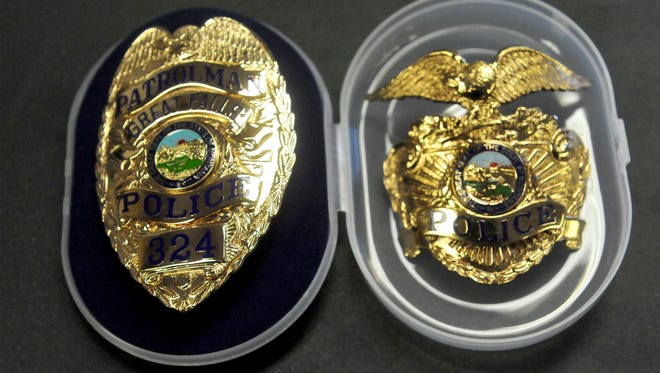 Three new Great Falls Police officers were sworn into duty on Wednesday morning by Judge Pinski in the City Commission Chambers of the Civic Center.