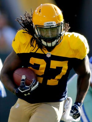 Green Bay Packers running back Eddie Lacy runs in the first quarter against the Dallas Cowboys at Lambeau Field.