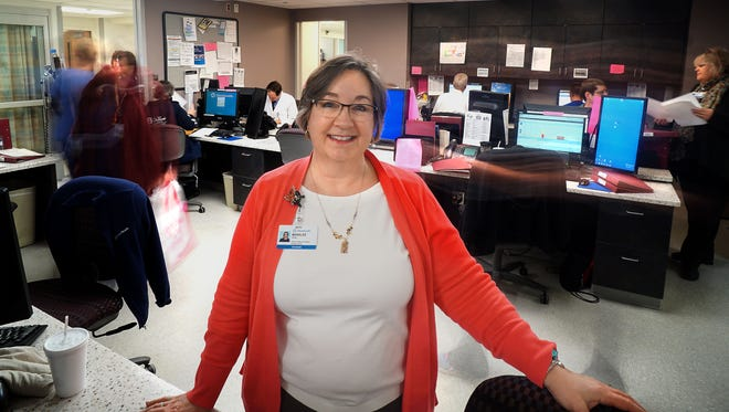 Marilee Spore poses for a photo in a busy ER on Tuesday afternoon. Spore is OhioHealth's full-time service excellence consultant.