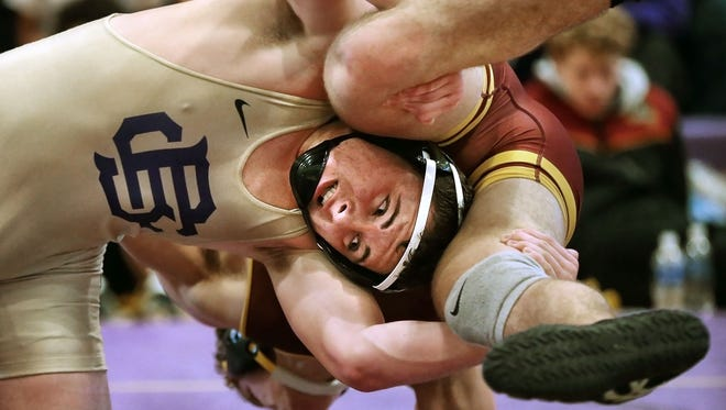 Christian Brothers' Andrew Sweatt keeps Science Hill's Weston Brown from escaping during the Christian Brother's Duals Wresting Tournament at CBHS.