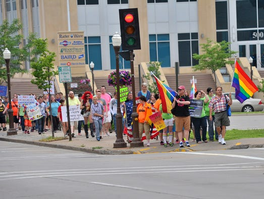 A line of people participate in the March for Equality second-annual event in support of gay rights/marriage, Saturday afternoon, from Marathon Park to the 400 Block in downtown Wausau.