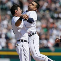 Detroit Tigers' Jose Iglesias, right, is hugged by second baseman Ian Kinsler after Iglesias' game winning single that drove in Andrew Romine during the ninth inning of a baseball game against the Chicago White Sox, Friday, April 17, 2015, in Detroit. The Tigers defeated the White Sox 2-1. (AP Photo/Carlos Osorio)