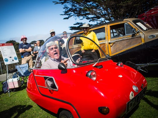 Jay Leno in red car