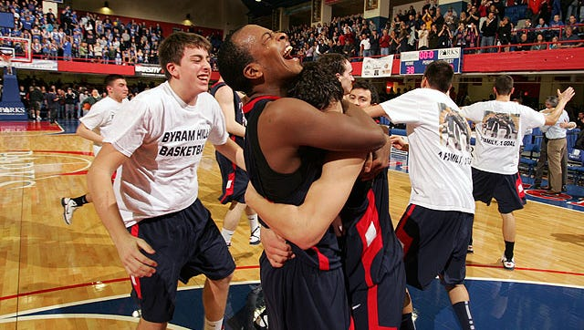 Byram Hills' Andrew Maloney celebrates with Jeff Lynch following a Section 1 Class A boys basketball championship at the Westchester County Center in White Plains March 6, 2011. Byram Hills is the No. 2 seed in a wide open Class A tournament this year.