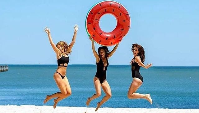 You'll jump for joy when you wear this summer's swimsuit trend of strappy tops and bottoms.