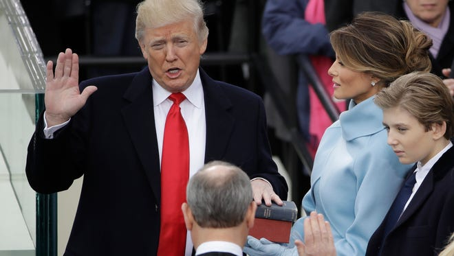 Donald Trump is sworn in as the 45th president of the United States by Chief Justice John Roberts as Melania Trump looks on during the 58th Presidential Inauguration at the U.S. Capitol in Washington on Friday.