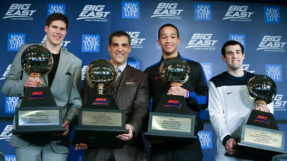 From left,  Creighton's Doug McDermott, player of the year, Villanova's head coach Jay Wright, coach of the year, DePaul's Billy Garrett Jr., rookie of the year, and Butler's Alex Barlow, scholar-athlete of the year, hold their trophies during a media availability prior to the start of 2014 Big East basketball tournament at Madison Square Garden, Wednesday, March 12, 2014, in New York.