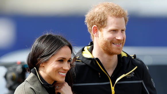 Prince Harry and Meghan Markle take in the UK team