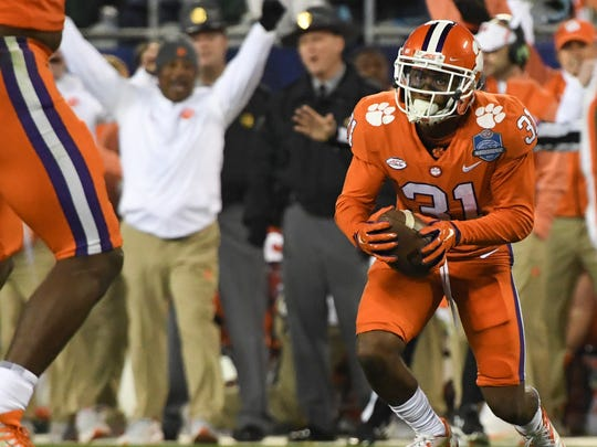 Clemson defensive back Ryan Carter (31) intercepts a ball against Miami during the first quarter of the Dr.Pepper ACC football championship in Charlotte on Saturday.