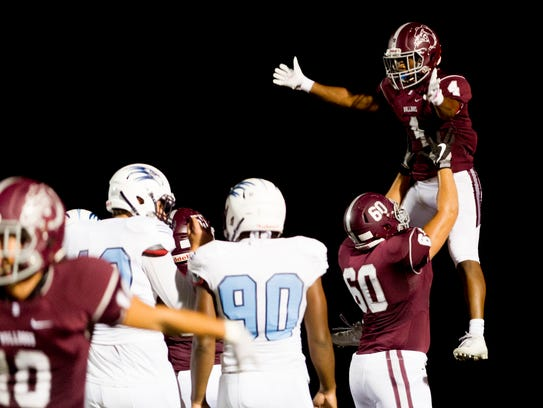 Bearden's Michael Clubb (60) lifts London Stephney (4) after a touchdown during a game between Bearden and Hardin Valley high schools at Bill Young Field in Knoxville, Tennessee on Friday, October 20, 2017.