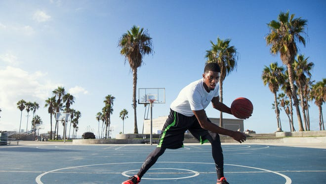 Former St. Clair County Community College men's basketball player Kieon Arkwright is training athletes all around the world