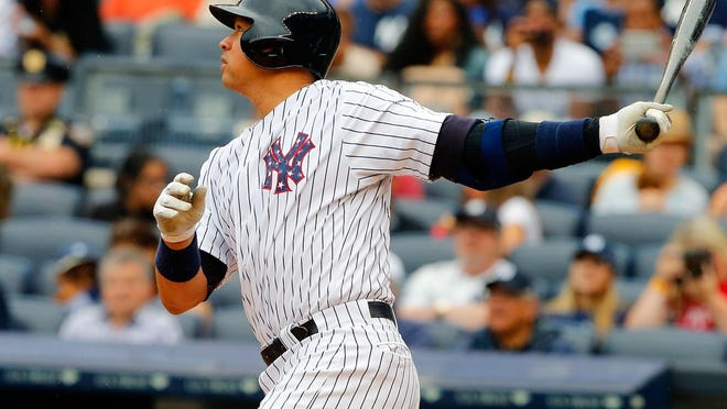 Alex Rodriguez follows through on a first-inning RBI base hit against the Tampa Bay Rays at Yankee Stadium on July 4.
