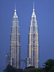 The Petronas Twin Towers at dusk in Kuala Lumpur,