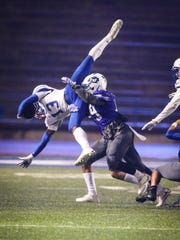 Lake View defender Bryan Trejo tackles Estacado ball