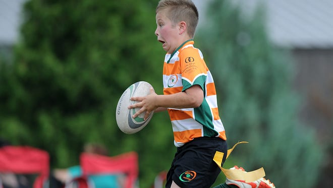 The Fond du Lac Youth Rugby team, The Boomers, hosted a youth flag rugby tournament for boys and girls Saturday, July 11, 2015, at Lakeside Park.