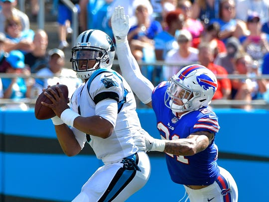CHARLOTTE, NC - SEPTEMBER 17:  Jordan Poyer #21 of the Buffalo Bills pressures Cam Newton #1 of the Carolina Panthers during their game at Bank of America Stadium on September 17, 2017 in Charlotte, North Carolina.  (Photo by Grant Halverson/Getty Images)