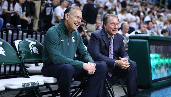 Michigan Stat basketball coach Tom Izzo and football coach Mark Dantonio sit on the bench prior to MSU's 71-67 win over Louisville Wednesday at the Breslin Center.