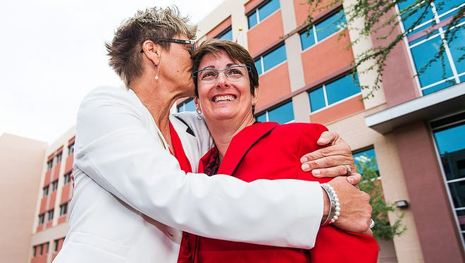 Sheila Kloefkorn (right) and Sue Wieger were the first female couple to line up at the Clerk of the Superior Court in Phoenix on Oct. 17, 2014, to get a marriage license.