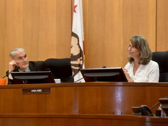 Ventura County Supervisor Steve Bennett, left, listens as Supervisor Linda Parks speaks during last week's meeting. Some believe Parks has become the swing vote on the Ventura County Board of Supervisors.
