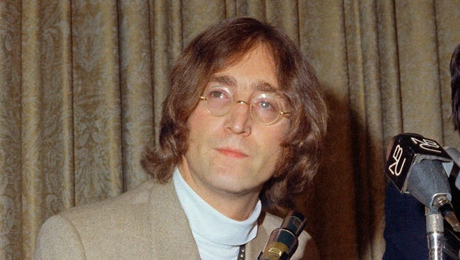 "In this 1971 file photo, singer John Lennon appears during a press conference. Publisher Houghton Mifflin Harcourt said Nov. 28 that it was publishing ""Imagine,"" inspired by the John Lennon classic of the same name. With illustrations by Jean Jullien, the book will feature Lennon's lyrics as it tells of a young pigeon's mission to advocate for peace. It comes out Sept. 21, 2017, the United Nations' International Day of Peace."