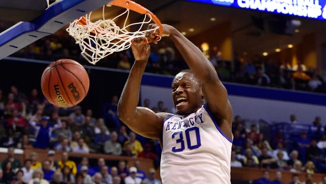 Kentucky Wildcats forward Julius Randle (30) dunks the ball ahead of Kansas State Wildcats guard Nigel Johnson (23) in the first half during the 2nd round of the 2014 NCAA Men's  Basketball Championship at Scottrade Center.